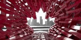 maple leaf sculpture with city skyline